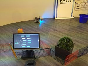 Scene with R5 robot in an enclosure with other objects